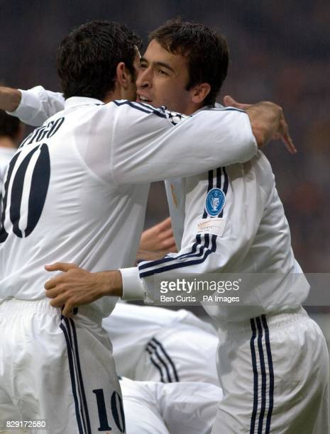 Goalscorer Raul Gonzalez is congratulated by teammate Luis Figo during the UEFA Champions League Final match between Real Madrid and Bayer Leverkusen...
