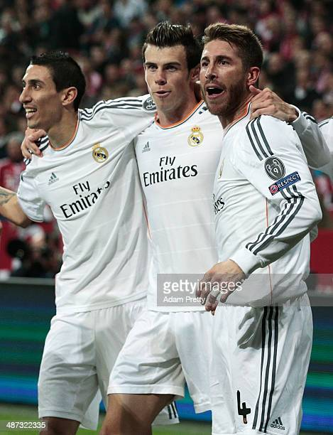 Goalscorer Sergio Ramos celebrates with Angel Di Maria and Gareth Bale of Real Madrid after his first goal during the UEFA Champions League semifinal...