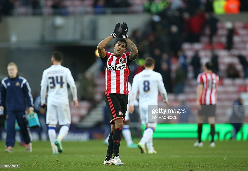 Goalscorer Sunderland's Dutch defender Patrick van Aanholt applauds supporters at the final whistle in the English FA Cup third round football match...