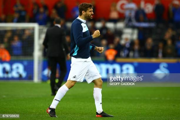 Goalscorer Swansea City's Spanish striker Fernando Llorente celebrates on the pitch after the English Premier League football match between Swansea...