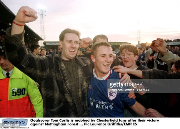 Goalscorer Tom Curtis is mobbed by Chesterfield fans after their victory against Nottingham Forest