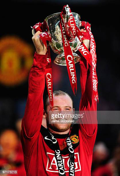 Goalscorer Wayne Rooney of Manchester United celebrates with the trophy after victory in the Carling Cup Final between Aston Villa and Manchester...