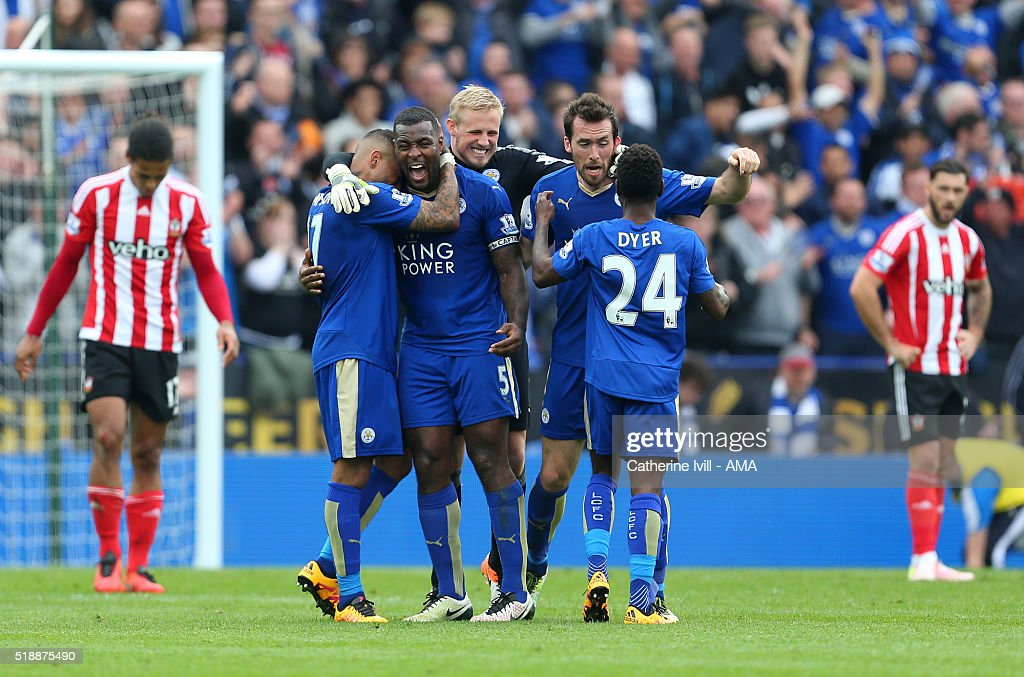Goalscorer Wes Morgan of Leicester City celebrates with his team mates Danny Simpson, Kasper Schmeichel, Christian Fuchs and Nathan Dyer of Leicester City at the end of the Barclays Premier League match between Leicester City and Southampton at The King Power Stadium on April 3, 2016 in Leicester, England.
