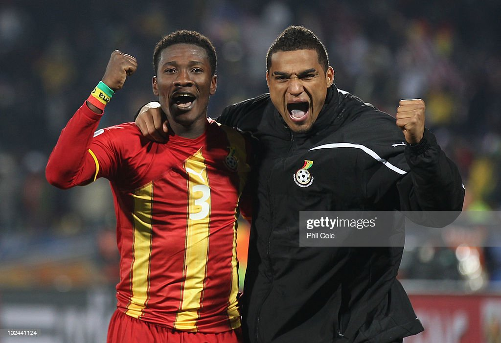 Goalscorers Asamoah Gyan and Kevin Prince Boateng of Ghana celebrate victory during the 2010 FIFA World Cup South Africa Round of Sixteen match...