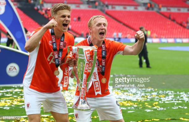 Goalscorers Brad Potts and Mark Cullen of Blackpool celebrate promotion to League One with the trophy after the Sky Bet League Two Playoff Final...