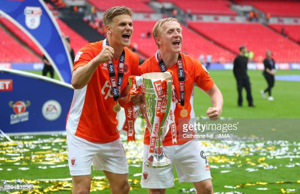 Goalscorers Brad Potts and Mark Cullen of Blackpool celebrate with the trophy during the Sky Bet League Two Playoff Final match between Blackpool and...