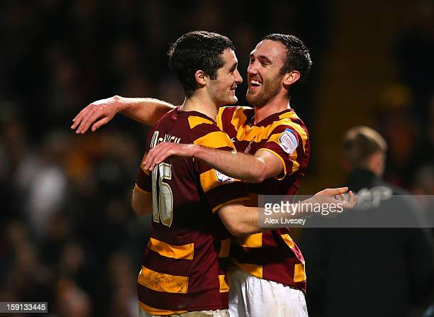 Goalscorers Carl McHugh and Rory McArdle of Bradford City celebrate after the Capital One Cup SemiFinal 1st Leg match between Bradford City and Aston...