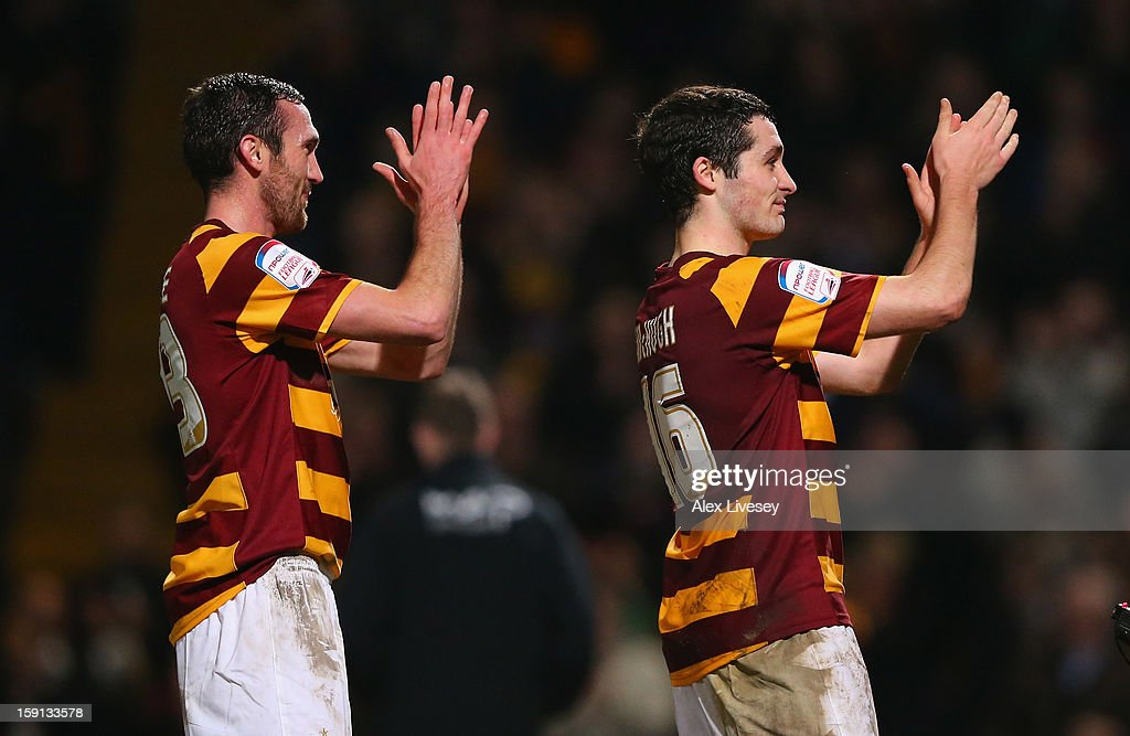 Goalscorers, Carl McHugh and Rory McArdle of Bradford City celebrate after the Capital One Cup Semi-Final 1st Leg match between Bradford City and Aston Villa at Coral Windows Stadium, Valley Parade on January 8, 2013 in Bradford, England.