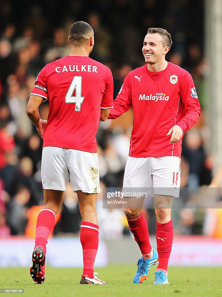 Goalscorers Jordon Mutch (R) and <a gi-track='captionPersonalityLinkClicked' href=/galleries/search?phrase=Steven+Caulker+-+Soccer+Player&family=editorial&specificpeople=6527106 ng-click='$event.stopPropagation()'>Steven Caulker</a> of Cardiff City celebrate victory after the Barclays Premier League match between Fulham and Cardiff City at Craven Cottage on September 28, 2013 in London, England.