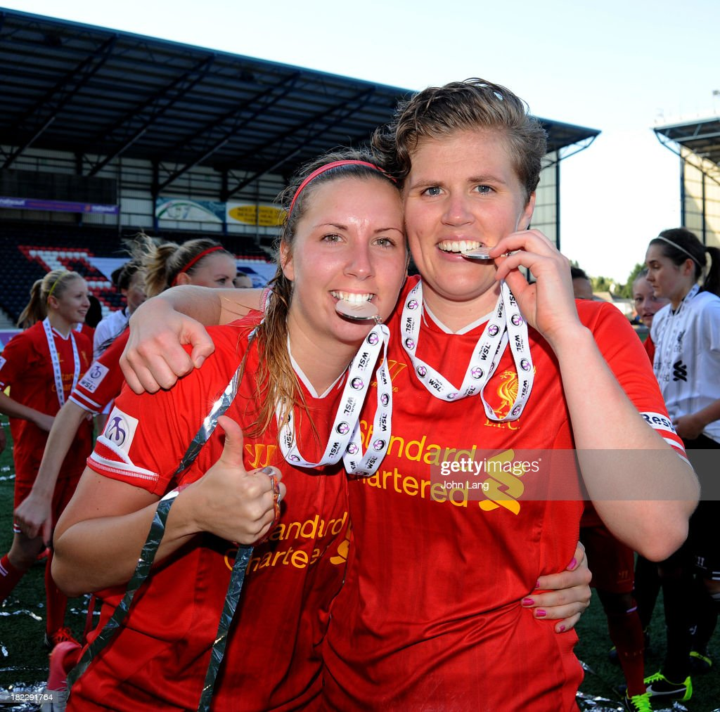 Goalscorers Louise Fors and Katrin Omarsdottir of Liverpool celebrates with their medals following victory in the FA Women's Super League match between Liverpool Ladies and Bristol Academy Women at the Halton Stadium on September 29, 2013 in Widnes, Cheshire, England.