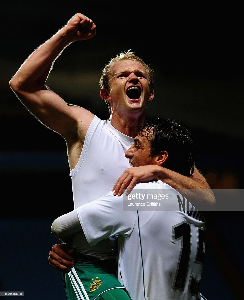 Goalscorers Mario Sonnleitner and Atdhe Nuhiu of SK Rapid Vienna celebrate on the fianl whistle during the UEFA Europa League play off second leg match between Aston Villa and SK Rapid Vienna at Villa Park on August 26, 2010 in Birmingham, England.