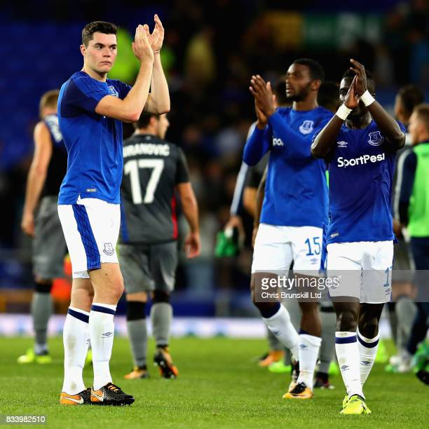 Goalscorers Michael Keane of Everton and Idrissa Gueye of Everton applaud the crowd after the UEFA Europa League Qualifying PlayOffs round first leg...