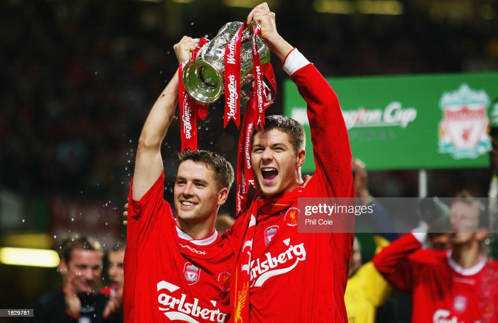 Goalscorers Michael Owen and <a gi-track='captionPersonalityLinkClicked' href=/galleries/search?phrase=Steven+Gerrard&family=editorial&specificpeople=202052 ng-click='$event.stopPropagation()'>Steven Gerrard</a> of Liverpool celebrate with the trophy during the Worthington Cup Final between Liverpool and Manchester United held on March 2, 2003 at the Millennium Stadium, in Cardiff, Wales. Liverpool won the match and final 2-0.