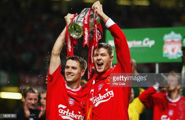 Goalscorers Michael Owen and Steven Gerrard of Liverpool celebrate with the trophy during the Worthington Cup Final between Liverpool and Manchester...