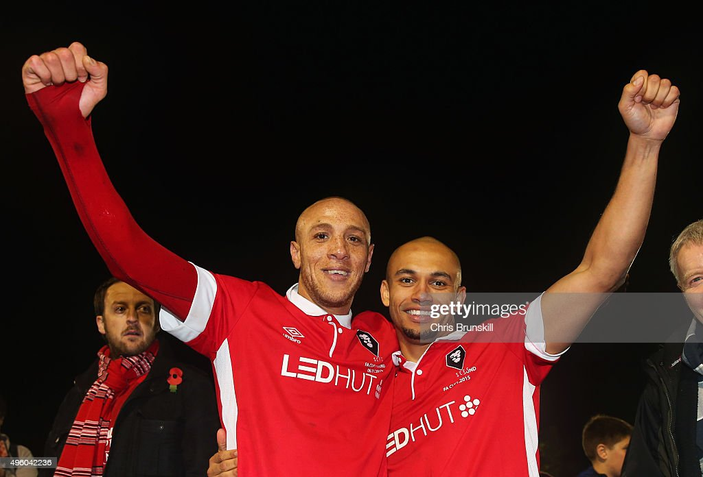 Goalscorers Richie Allen and Danny Webber (R) of Salford City celerbate victory after the Emirates FA Cup first round match between Salford City and Notts County at Moor Lane on November 6, 2015 in Salford, England.