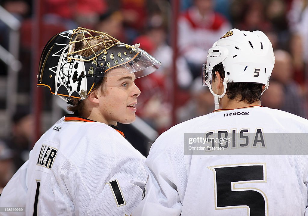 Goaltedner Jonas Hiller #1 of the Anaheim Ducks talks with Luca Sbisa #5 during the NHL game against the Phoenix Coyotes at Jobing.com Arena on March 4, 2013 in Glendale, Arizona. The Coyotes defeated the Ducks 5-4 in an overtime shootout.