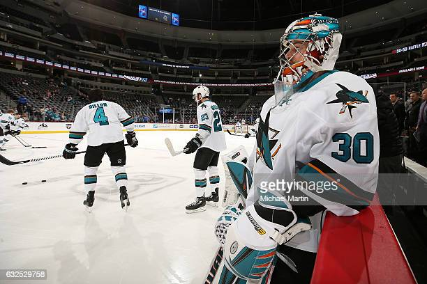Goaltender Aaron Dell of the San Jose Sharks rests on the boards during warm ups prior to the game against the Colorado Avalanche at the Pepsi Center...
