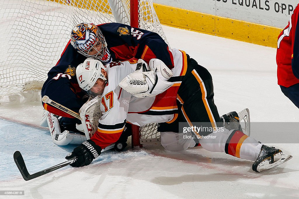Goaltender Al Montoya #35 of the Florida Panthers collides with Lance Bouma #17 of the Calgary Flames at the BB&T Center on November 8, 2014 in Sunrise, Florida.