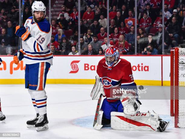 Goaltender Al Montoya of the Montreal Canadiens makes a save near Patrick Maroon of the Edmonton Oilers during the NHL game at the Bell Centre on...