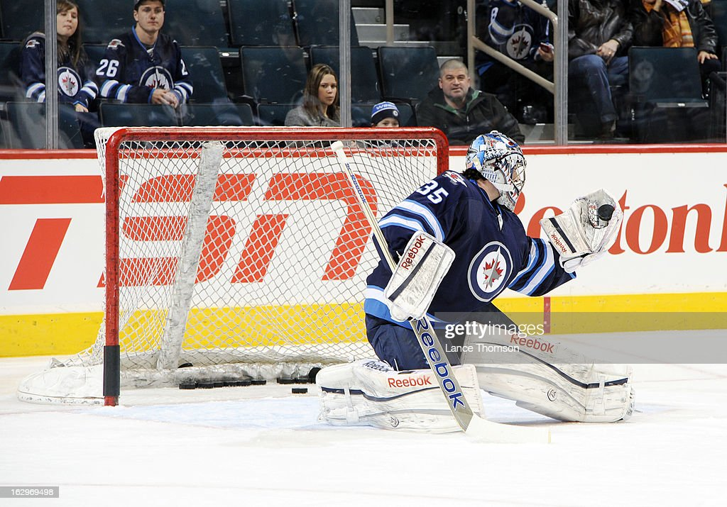 Goaltender <a gi-track='captionPersonalityLinkClicked' href=/galleries/search?phrase=Al+Montoya&family=editorial&specificpeople=213916 ng-click='$event.stopPropagation()'>Al Montoya</a> #35 of the Winnipeg Jets catches the puck in his glove during the pre-game warm prior to NHL action against the Washington Capitals at the MTS Centre on March 2, 2013 in Winnipeg, Manitoba, Canada.