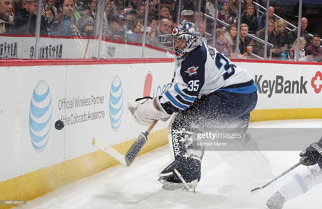 Goaltender <a gi-track='captionPersonalityLinkClicked' href=/galleries/search?phrase=Al+Montoya&family=editorial&specificpeople=213916 ng-click='$event.stopPropagation()'>Al Montoya</a> #35 of the Winnipeg Jets clears the puck against the Colorado Avalanche at the Pepsi Center on December 29, 2013 in Denver, Colorado.
