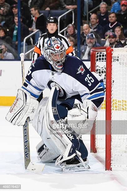 Goaltender Al Montoya of the Winnipeg Jets defends the net against the Columbus Blue Jackets on December 16 2013 at Nationwide Arena in Columbus Ohio
