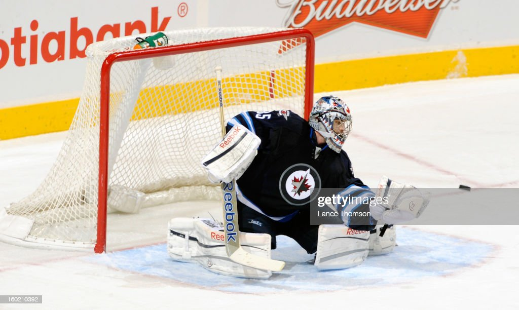 Goaltender Al Montoya #35 of the Winnipeg Jets gets set to catch the puck during second period action against the New York Islanders at the MTS Centre on January 27, 2013 in Winnipeg, Manitoba, Canada.