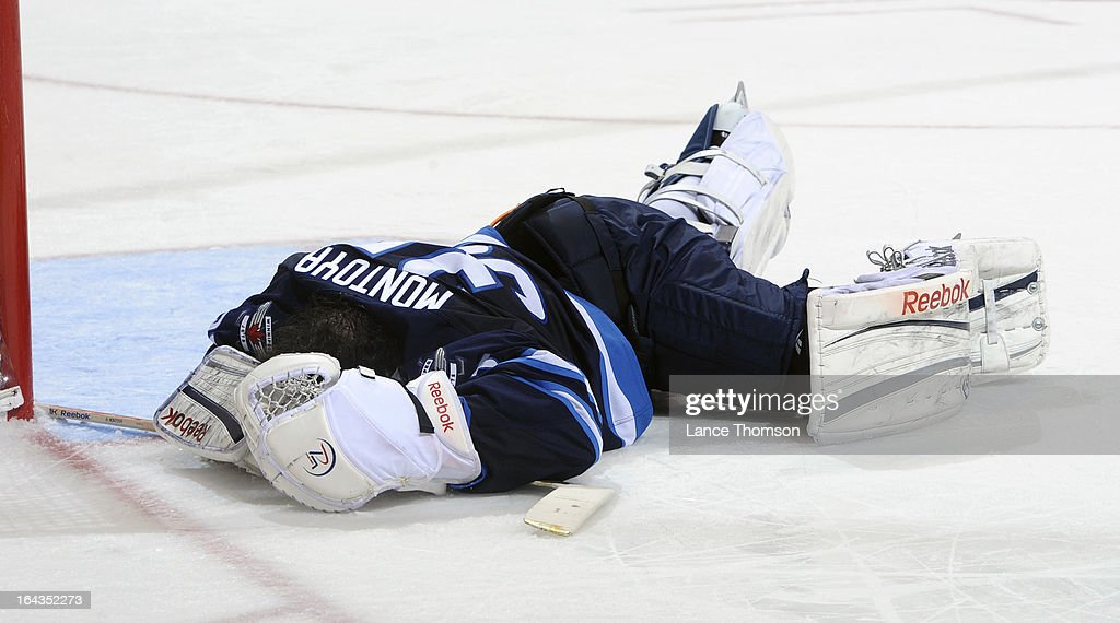 Goaltender <a gi-track='captionPersonalityLinkClicked' href=/galleries/search?phrase=Al+Montoya&family=editorial&specificpeople=213916 ng-click='$event.stopPropagation()'>Al Montoya</a> #35 of the Winnipeg Jets lays on ice after being hit by Jay Beagle #83 of the Washington Capitals (not shown) during third period action at the MTS Centre on March 22, 2013 in Winnipeg, Manitoba, Canada.