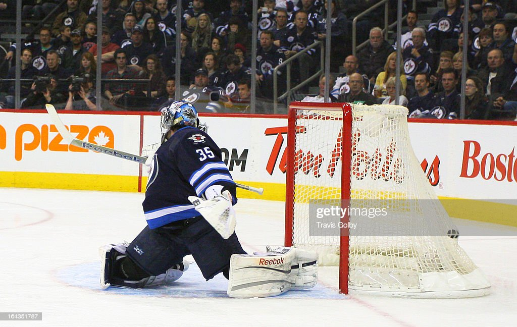 Goaltender <a gi-track='captionPersonalityLinkClicked' href=/galleries/search?phrase=Al+Montoya&family=editorial&specificpeople=213916 ng-click='$event.stopPropagation()'>Al Montoya</a> #35 of the Winnipeg Jets looks can't make the stop on a shot by Alex Ovechkin (not pictured) of the Washington Capitals \at the MTS Centre on March 22, 2013 in Winnipeg, Manitoba, Canada.