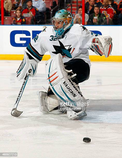 Goaltender Alex Stalock of the San Jose Sharks defends the net against the Florida Panthers at the BBT Center on January 16 2014 in Sunrise Florida