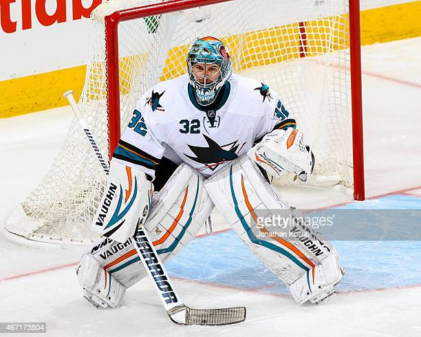 Goaltender Alex Stalock of the San Jose Sharks guards the net during third period action against the Winnipeg Jets on March 17 2015 at the MTS Centre...