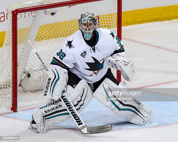 Goaltender Alex Stalock of the San Jose Sharks guards the net during third period action against the Winnipeg Jets at the MTS Centre on January 12...