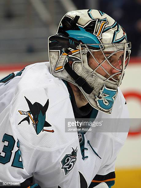 Goaltender Alex Stalock of the San Jose Sharks looks on during second period action against the Winnipeg Jets at the MTS Centre on January 12 2016 in...