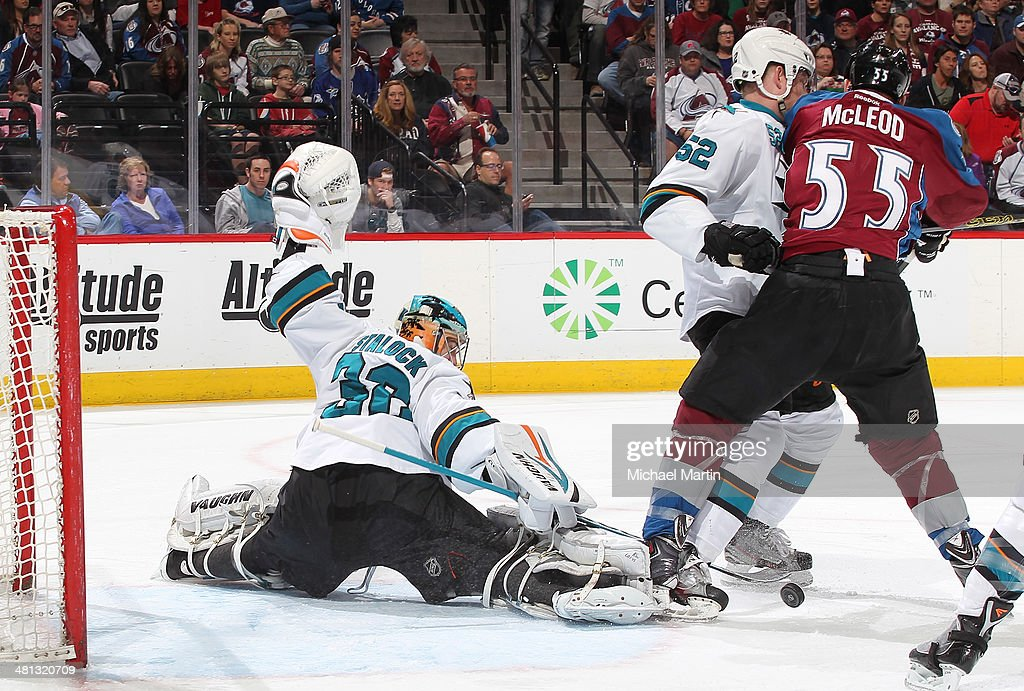 Goaltender Alex Stalock of the San Jose Sharks makes a save as teammate Matt Irwin defends against Cody McLeod of the Colorado Avalanche at the Pepsi...