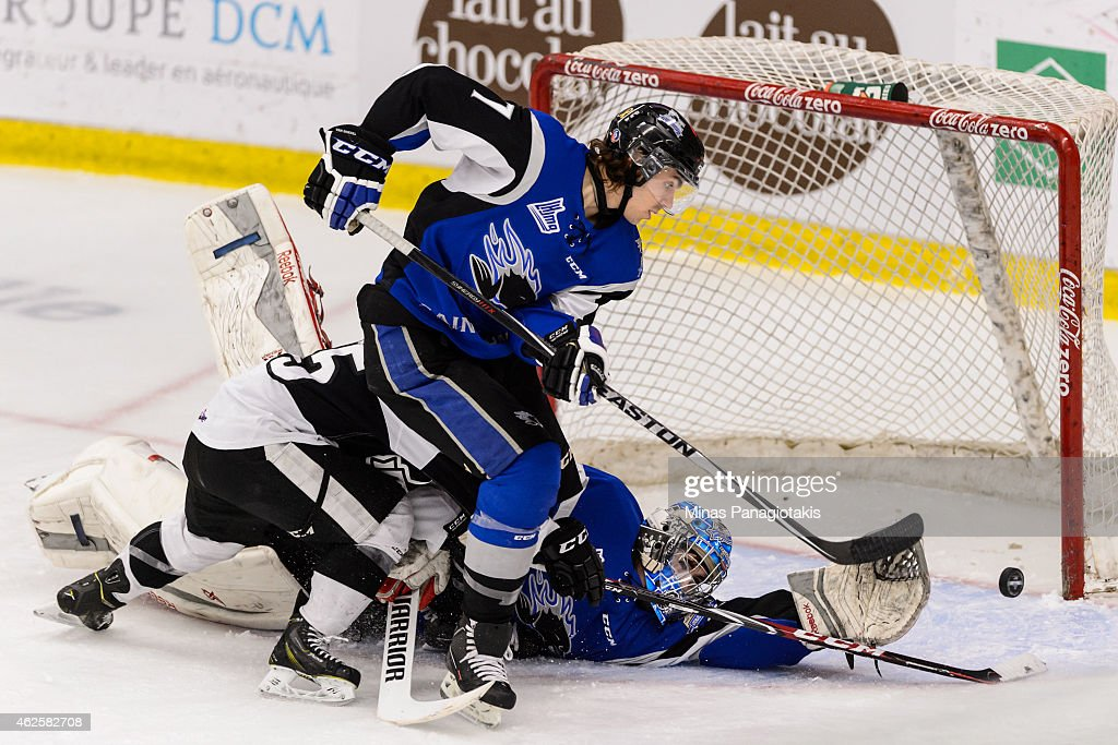 Goaltender Alexander Bishop #31 of the Saint John Sea Dogs dives to make a save while teammate Jack Van Boekel #7 stays close to defend the rebound during the QMJHL game against the Blainville-Boisbriand Armada at the Centre Excellence Rousseau on January 31, 2015 in Blainville-Boisbriand, Quebec, Canada. The Blainville-Boisbriand Armada defeated the Saint John Sea Dogs 4-0.