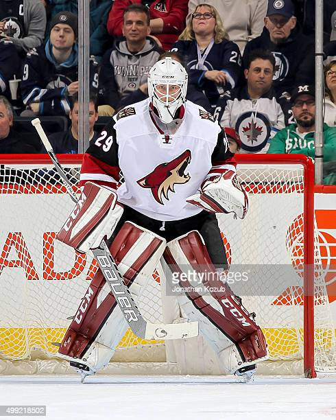 Goaltender Anders Lindback of the Arizona Coyotes guards the net during firstperiod action against the Winnipeg Jets at the MTS Centre on November 21...