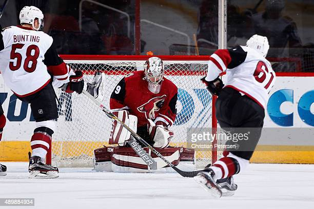 Goaltender Anders Lindback of the Red team makes a save on the shot from Dysin Mayo of the White team during the second period of the Arizona Coyotes...
