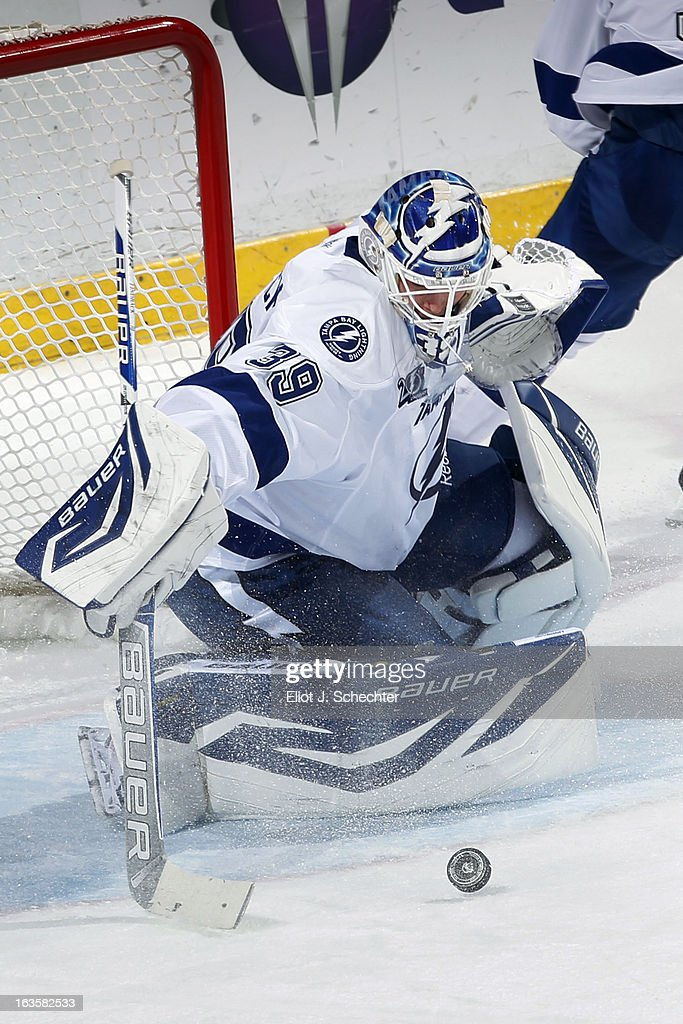 Goaltender <a gi-track='captionPersonalityLinkClicked' href=/galleries/search?phrase=Anders+Lindback&family=editorial&specificpeople=7211274 ng-click='$event.stopPropagation()'>Anders Lindback</a> #39 of the Tampa Bay Lightning defends the net against the Florida Panthers at the BB&T Center on March 12, 2013 in Sunrise, Florida.