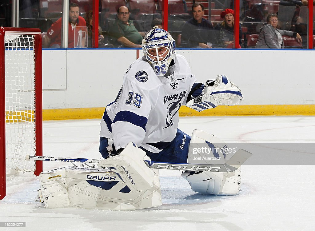 Goaltender <a gi-track='captionPersonalityLinkClicked' href=/galleries/search?phrase=Anders+Lindback&family=editorial&specificpeople=7211274 ng-click='$event.stopPropagation()'>Anders Lindback</a> #39 of the Tampa Bay Lightning defends the net against the Florida Panthers during first period action at the BB&T Center on September 28, 2013 in Sunrise, Florida.