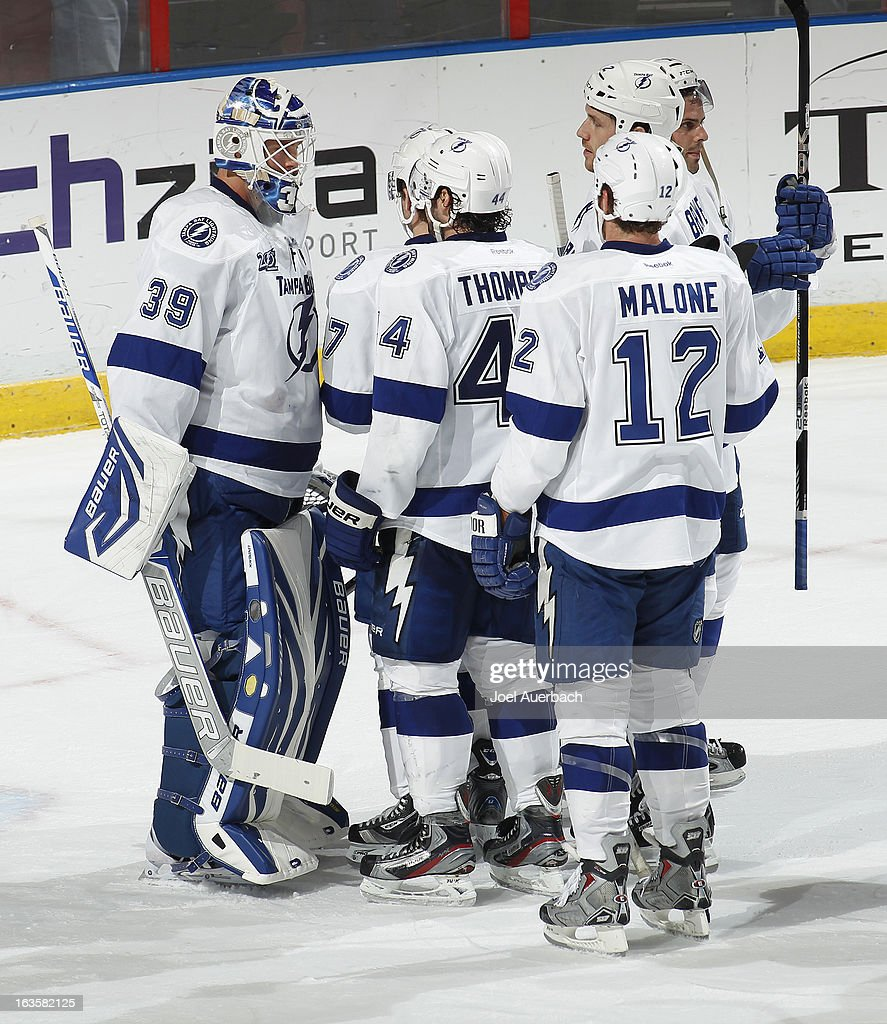 Goaltender <a gi-track='captionPersonalityLinkClicked' href=/galleries/search?phrase=Anders+Lindback&family=editorial&specificpeople=7211274 ng-click='$event.stopPropagation()'>Anders Lindback</a> #39 of the Tampa Bay Lightning is congratulated by teammates at the conclusion of the game against the Florida Panthers at the BB&T Center on March 12, 2013 in Sunrise, Florida. The Lightning defeated the Panthers 3-2.
