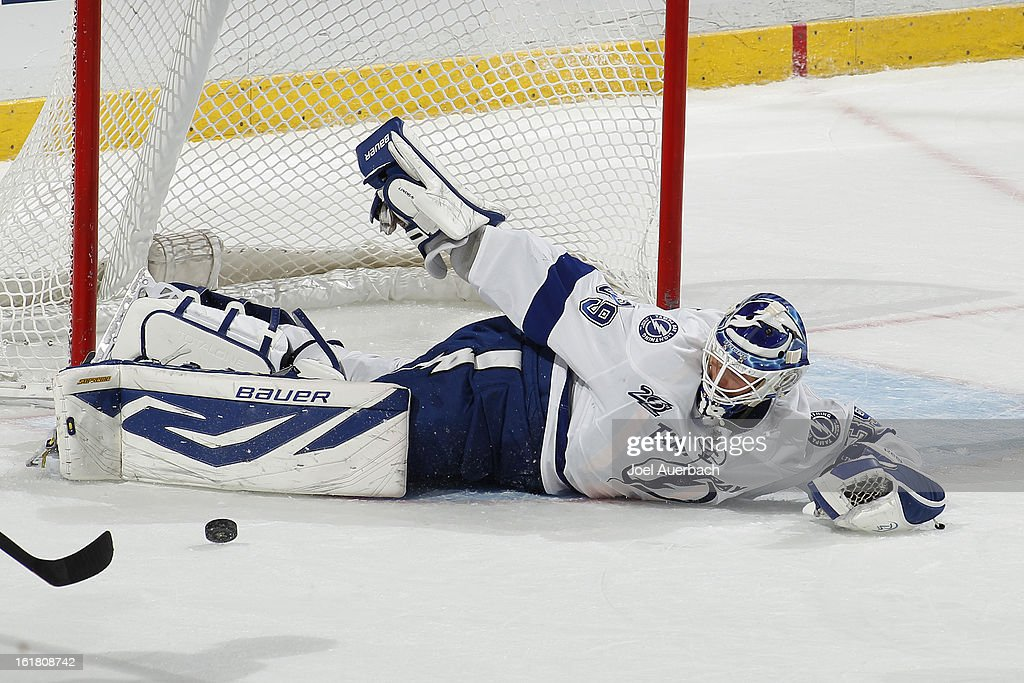 Goaltender <a gi-track='captionPersonalityLinkClicked' href=/galleries/search?phrase=Anders+Lindback&family=editorial&specificpeople=7211274 ng-click='$event.stopPropagation()'>Anders Lindback</a> #39 of the Tampa Bay Lightning loses his stick but makes a save against the Florida Panthers at the BB&T Center on February 16, 2013 in Sunrise, Florida. The Lightning defeated the Panthers 6-5 in overtime.