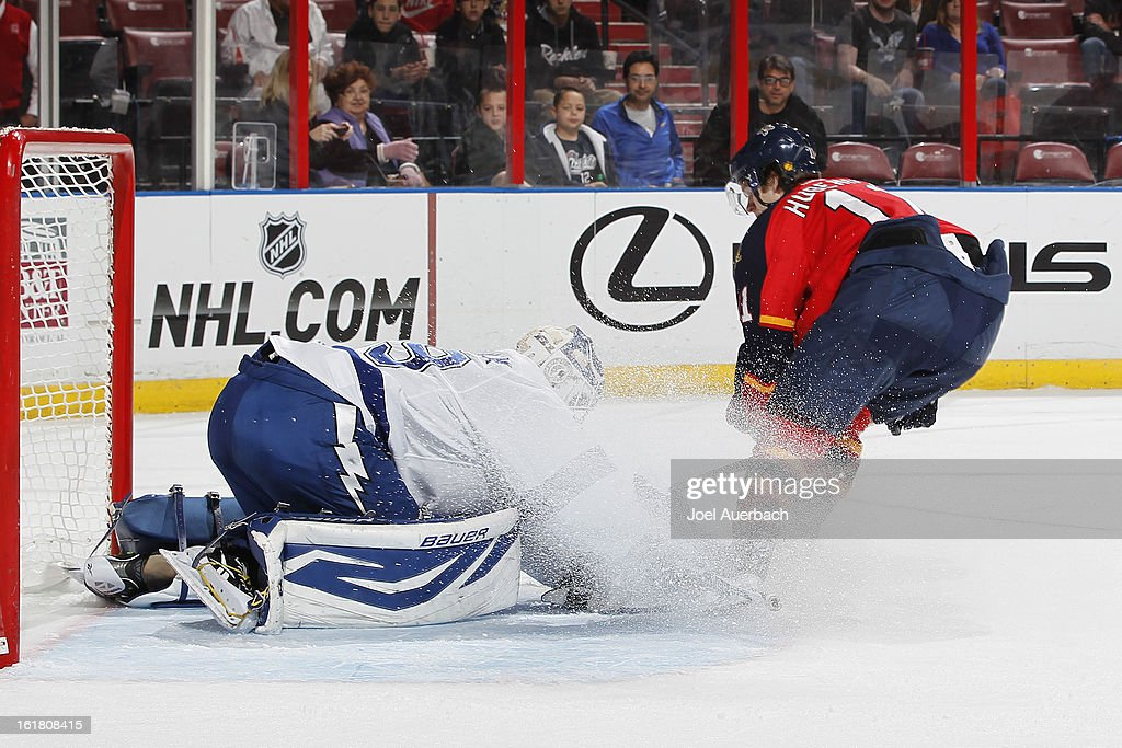 Goaltender <a gi-track='captionPersonalityLinkClicked' href=/galleries/search?phrase=Anders+Lindback&family=editorial&specificpeople=7211274 ng-click='$event.stopPropagation()'>Anders Lindback</a> #39 of the Tampa Bay Lightning stops a third period shot by <a gi-track='captionPersonalityLinkClicked' href=/galleries/search?phrase=Jonathan+Huberdeau&family=editorial&specificpeople=7144196 ng-click='$event.stopPropagation()'>Jonathan Huberdeau</a> #11 of the Florida Panthers at the BB&T Center on February 16, 2013 in Sunrise, Florida. The Lightning defeated the Panthers 6-5 in overtime.