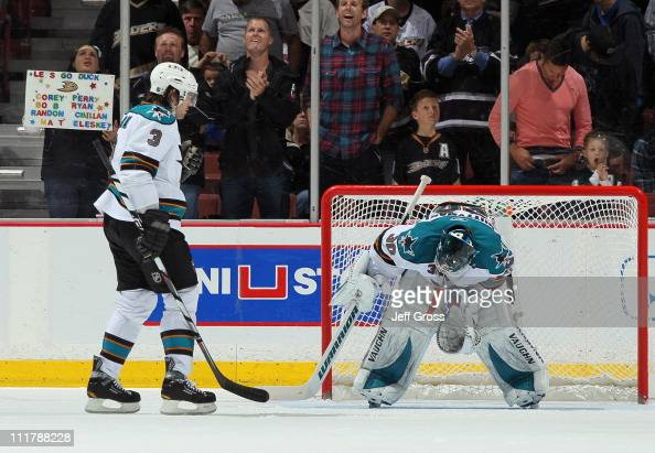 Goaltender Antero Niittymaki of the San Jose Sharks looks down after giving up a second period goal to Teemu Selanne of the Anaheim Ducks as Douglas...