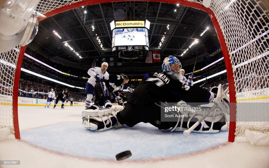 Goaltender Antero Niittymaki #30 of the Tampa Bay Lightning looks back at the net after Nikolai Kulemin #41 of the Toronto Maple Leafs scored during the first period at the St. Pete Times Forum on November 25, 2009 in Tampa, Florida.
