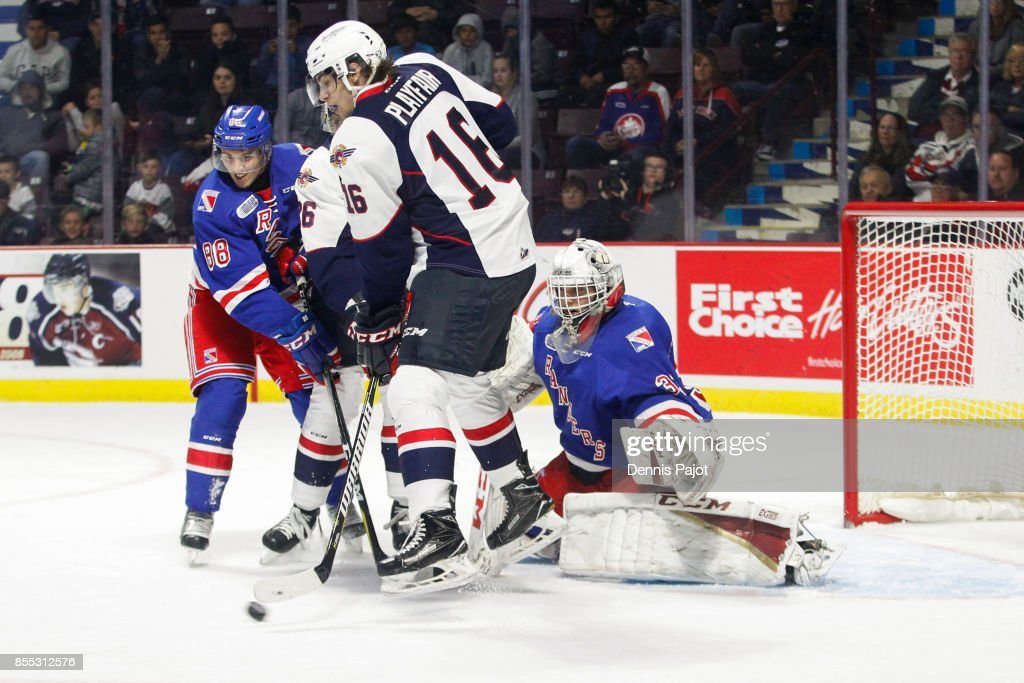 Goaltender Anthony Dumont-Bouchard #33 of the Kitchener Rangers makes a stop on a deflection from forward Chris Playfair #16 of the Windsor Spitfires on September 28, 2017 at the WFCU Centre in Windsor, Ontario, Canada.