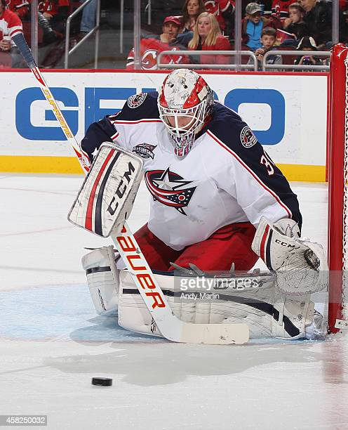 Goaltender Anton Forsberg of the Columbus Blue Jackets playing in his first NHL game eyes the puck after making a pad save against the New Jersey...