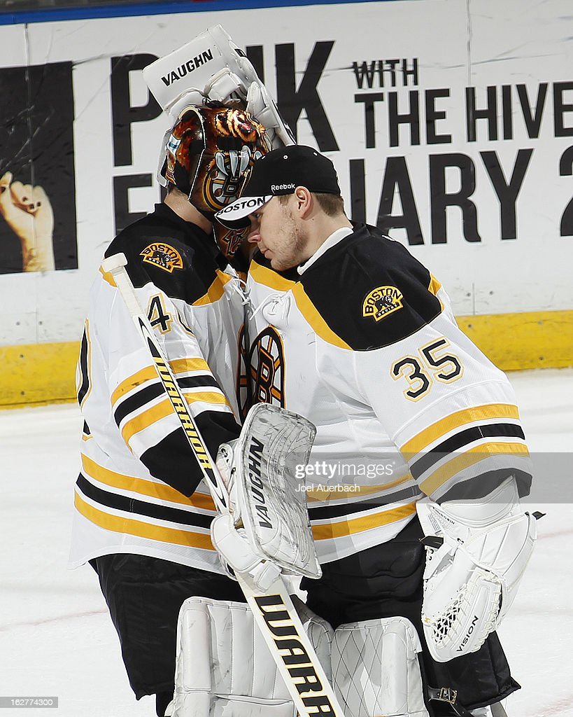 Goaltender Anton Khudobin #35 of the Boston Bruins congratulates goaltender Tuukka Rask #40 after his game against the Florida Panthers at the BB&T Center on February 24, 2013 in Sunrise, Florida. The Bruins defeated the Panthers 4-1.