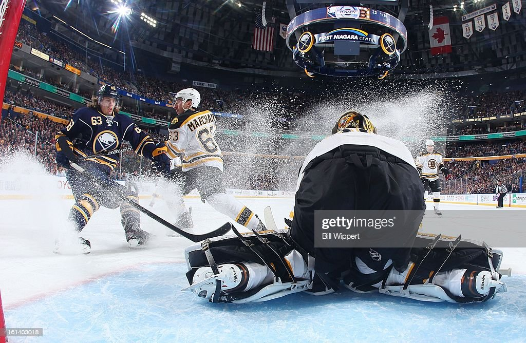 Goaltender Anton Khudobin #35 of the Boston Bruins covers the puck in front of teammate Brad Marchand #63 and Tyler Ennis #63 of the Buffalo Sabres on February 10, 2013 at the First Niagara Center in Buffalo, New York.