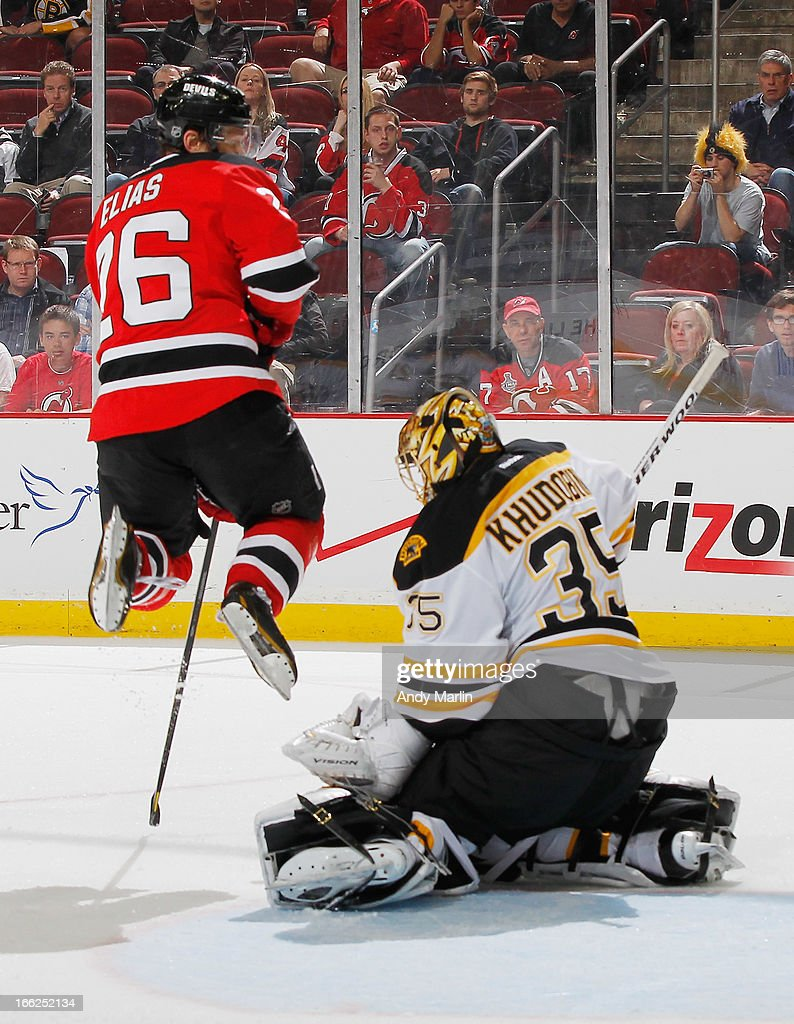 Goaltender <a gi-track='captionPersonalityLinkClicked' href=/galleries/search?phrase=Anton+Khudobin&family=editorial&specificpeople=722106 ng-click='$event.stopPropagation()'>Anton Khudobin</a> #35 of the Boston Bruins defends his while being screened by <a gi-track='captionPersonalityLinkClicked' href=/galleries/search?phrase=Patrik+Elias&family=editorial&specificpeople=201827 ng-click='$event.stopPropagation()'>Patrik Elias</a> #26 of the New Jersey Devils during the game at the Prudential Center on April 10, 2013 in Newark, New Jersey. The Bruins defeated the Devils 5-4.