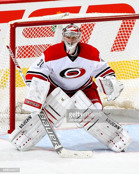 Goaltender Anton Khudobin of the Carolina Hurricanes gets set in the crease during second period action against the Winnipeg Jets on October 21 2014...